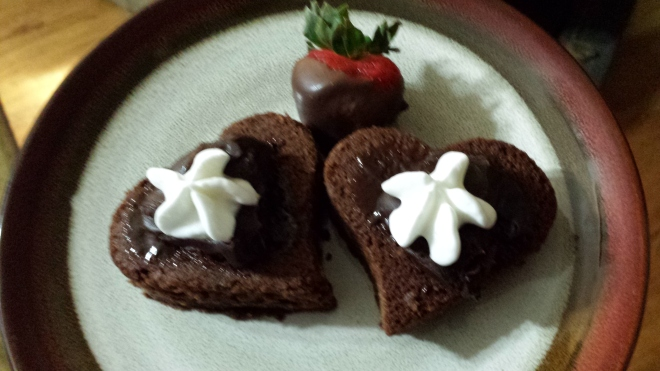 Heart-shaped brownies with chocolate ganache, chocolate covered strawberry.