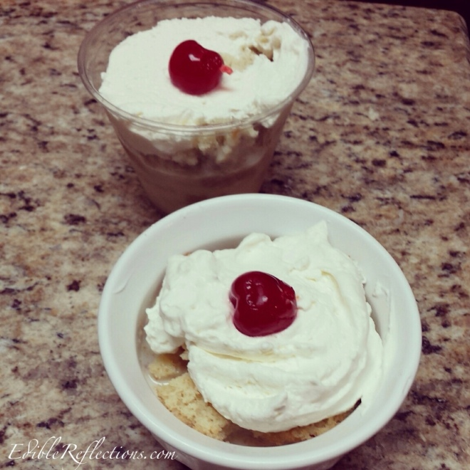 Mini Tres Leches Cakes with homemade whipped cream and cherry.