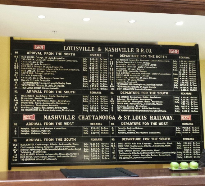 Railroad schedule still hangs on the wall behind the lobby - Union Station Hotel Nashville