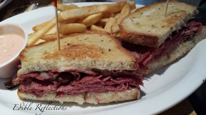 The Rachel (Pastrami, sauerkraut and swiss on grilled rye) - Noshville Delicatessen