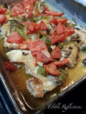 Chicken with tomates, onions, peppers, mushrooms just out of the oven