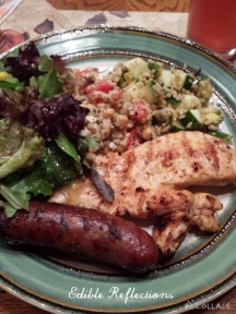 Quinoa salad, grilled chicken breast, sausage, green salad and wild rice mix.